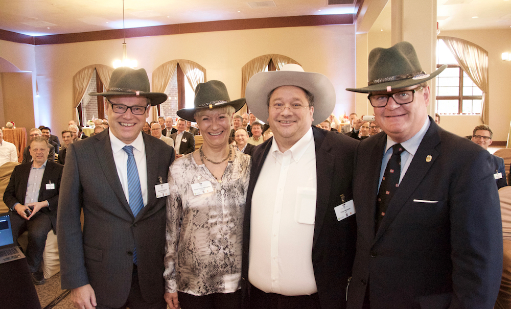 Trey Mebane brought gifts for his Norwegian friend to make them look more cowboy-e: (left-right) Morten Paulsen, Consul General at the Norwegian Consulate in Houston, Anne-Grete Ellingsen, CEO of GCE NODE, Trey Mebane and Harald Furre, Mayor of Kristiansand.